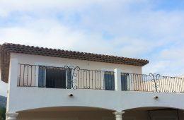 Ornamental wrought iron scroll stair rail & balcony guardrail in Le Tignet