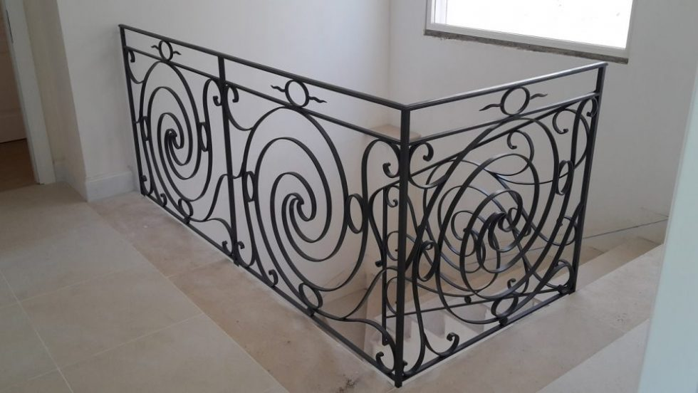 Elegant scroll design interior stair rail and straight balcony guard rail in Antibes